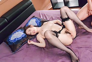Woman in Japanese stockings ends porn play with creampie
