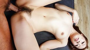 Hitomi Oki gets her hairy Asian pussy jizzed well