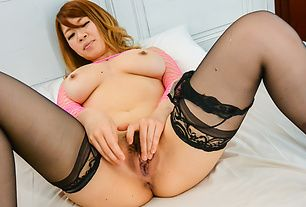 Babe with perfect Japanese tits enjoys toy insertion