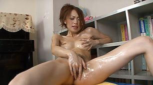 Oiled Asian milf plays with pussy in sexy solo