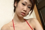 Japanese lingerie model receives cock between her tits Photo 1