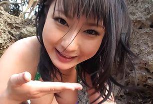 Horny asian milf Megumi Haruka sucks dick at the beach