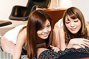 Nao and Yuria tag team a lucky guy's cock in POV Photo 1