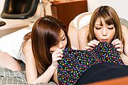Nao and Yuria tag team a lucky guy's cock in POV Photo 2