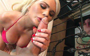 Sexy blonde sucks, titty fucks and gets fucked in bed by a stud